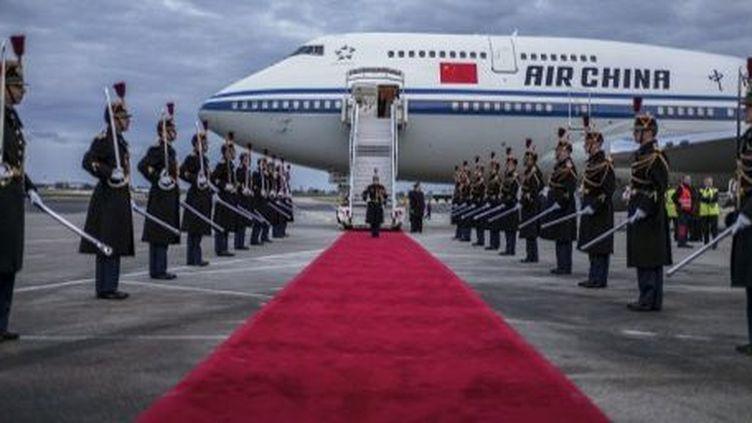 Tapis rouge pour les investissements chinois en France (JEFF PACHOUD / AFP)