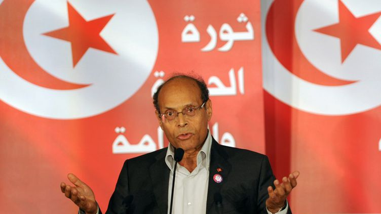 Le président tunisien, Moncef Marzouki, fait un discours à l'occasion de l'anniversaire du départ de l'ancien président Ben Ali, le 14 janvier 2012 à Tunis. (FETHI BELAID / AFP)