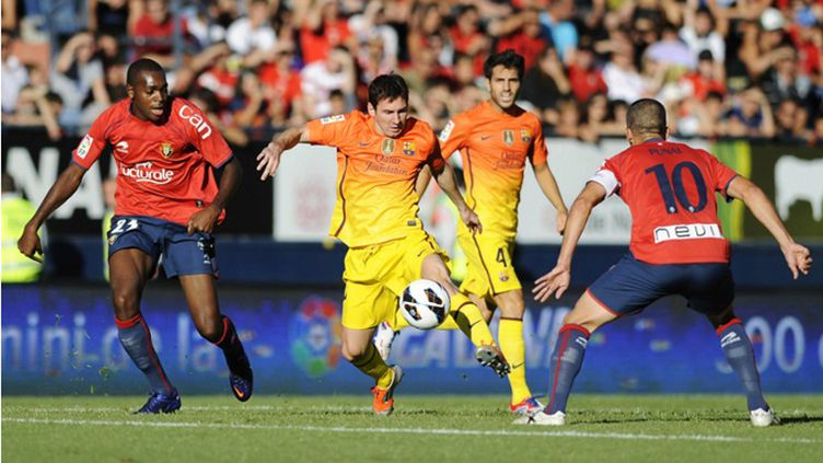 La grande complicité de Messi et Villa sous le maillot de Barcelone (RAFA RIVAS / AFP)