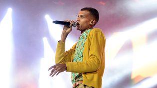 """Stromae, prix de la chanson de l'année de la Sacem, pour """"Formidable"""" (ici à Saint-Denis le 28 septembre 2013)  (Pierre Andrieu / AFP)"""
