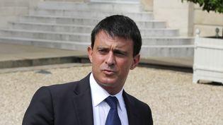 Le ministre de l'Intérieur, Manuel Valls, le 24 juillet 2013 à Paris. (FRANCOIS GUILLOT / AFP)