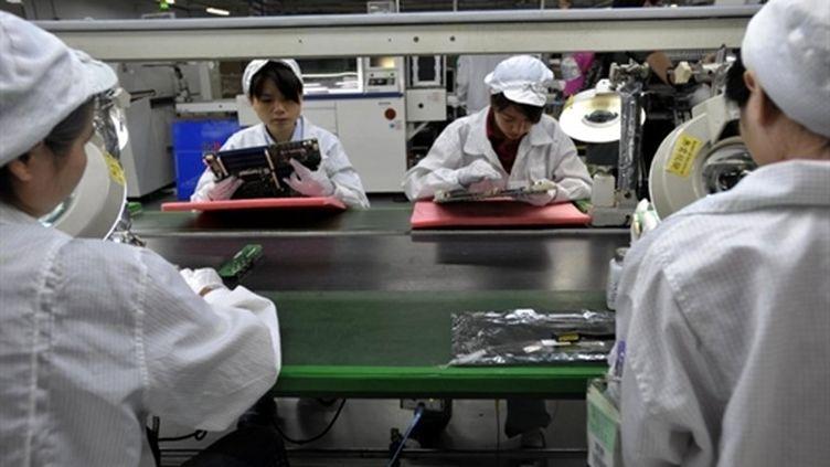 Des ouvrières de l'usine Foxconn à Shenzhen, frappée par une vague de suicides (mai 2010) (AFP)