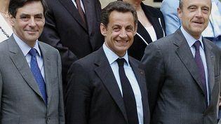 François Fillon, Nicolas Sarkozy et Alain Juppé, le 18 mai 2007 à Paris. (STEPHANE DE SAKUTIN / AFP)