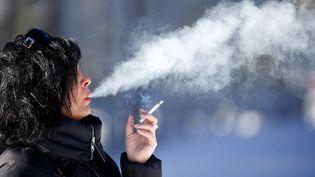 La loi Touraine prévoit des mesures de lutte anti-tabac. (GODONG / BSIP/ AFP)