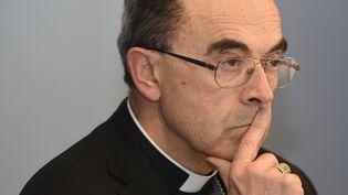 Le cardinal Barbarin lors d'une conférence de presse à Lourdes (Hautes-Pyrénées), le 15 mars 2016. (ERIC CABANIS / AFP)