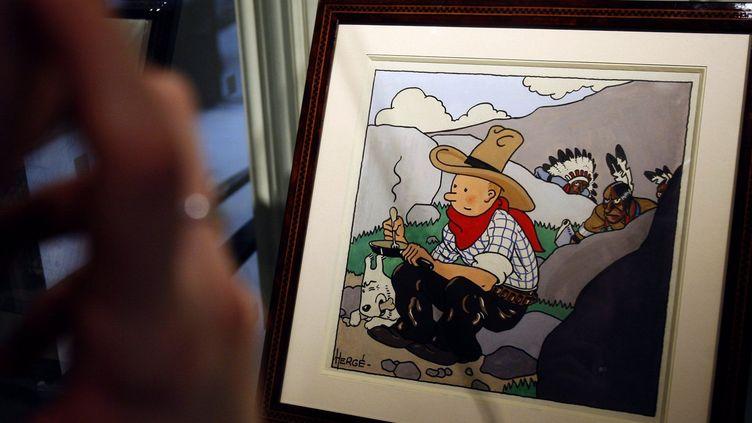 """Gouache réalisée en 1932 par Hergé pour la couverture de """"Tintin en Amérique""""  (François Guillot/AFP)"""