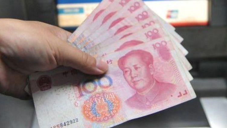 De la révolution à l'argent... Mao illustre les billets de banque chinois. (AFP/HU JIANHUANG NJ / IMAGINECHINA)