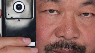Ai Weiwei et sa webcam, que les autorités chinoises lui ont ordonné de déconnecter  (Ed Jones / AFP)