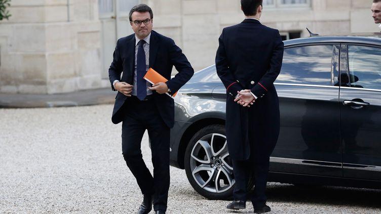 Thomas Thévenoud sortant de sa voiture de fonction, le 1er septembre 2014 dans la cour de l'Elysée (Paris). (  MAXPPP)