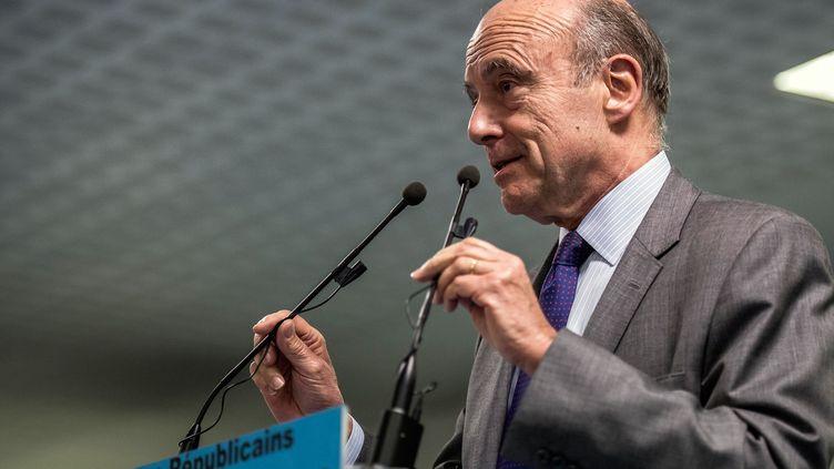 Alain Juppé, ancien Premier ministre et actuel maire UMP de Bordeaux, le 12 mars 2015 à Albertville (Savoie). (JEAN-PHILIPPE KSIAZEK / AFP)