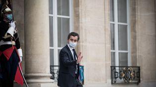 Le ministre de l'Intérieur Gérald Darmanin quitte le palais de l'Elysée, à Paris, le 25 novembre 2020. (ARTHUR NICHOLAS ORCHARD / HANS LUCAS / AFP)