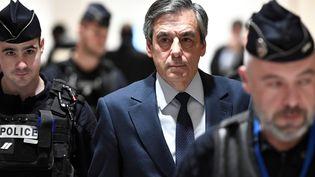 François Fillon au palais de Justice de Paris lors de leur procès pour des soupçons d'emploi fictif, le27 février 2020. (STEPHANE DE SAKUTIN / AFP)