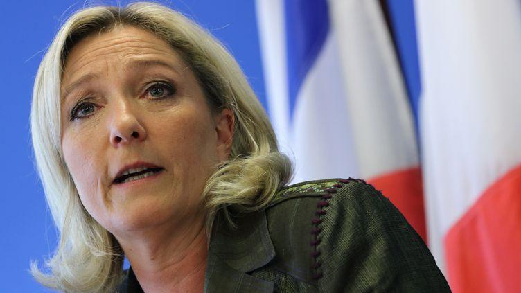 Marine Le Pen, présidente du Front national, lors d'une conférence de presse à Nanterre (Hauts-de-Seine), le 25 juin 2013. (PHILIPPE WOJAZER / REUTERS)