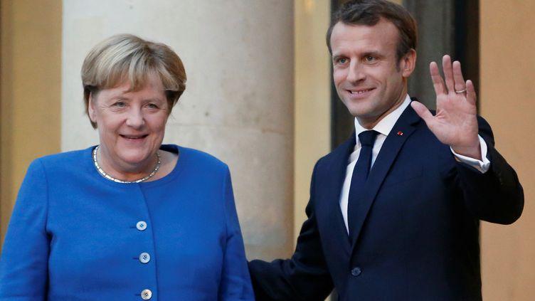 Angela Merkel rencontre Emmanuel Macron à l'Elysée (Paris), le 13 octobre 2019. (REGIS DUVIGNAU / REUTERS)