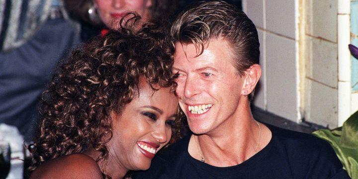 David Bowie et Iman le 19 sept 1991 au club Les Bains Douches à Paris.  (François Marit / AFP)