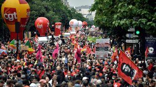 Des manifestants contre le projet de loi travail, le 28 juin 2016 à Paris. (PHILIPPE LOPEZ / AFP)