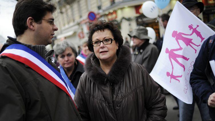 Christine Boutin (à d.), lors de la manifestation contre le mariage des homosexuels, le 13 janvier 2013 à Paris. (FRED DUFOUR / AFP)