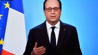 François Hollande lors de discours pour annoncer qu'il ne se représentera pas à l'éleciton présidentielle, le 1er décembre 2016. (OLIVIER MORIN / AFP)