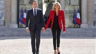 Emmanuel et Brigitte Macron à l'Elysée, à Paris, le 6 juillet 2017. (AFP)