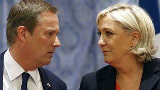 Nicolas Dupont-Aignan et Marine Le Pen, le 29 avril 2017, à Paris. (GEOFFROY VAN DER HASSELT / AFP)