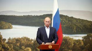 Vladimir Poutine, en juin 2013. Le président russe soutient son homologue ukrainien contesté, Viktor Ianoukovitch, car il entend garder l'Ukraine dans son giron. (MATT DUNHAM / POOL)