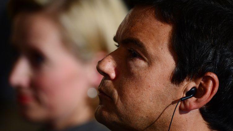 L'économiste Thomas Piketty lors d'un débat au ministère de l'Economie allemand, à Berlin, le 7 novembre 2014. (JOHN MACDOUGALL / AFP)