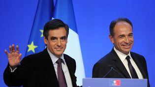 Le Premier ministre, François Fillon, et le secrétaire général de l'UMP, Jean-François Copé, le 28 janvier 2012 à Paris. (JOHANNA LEGUERRE / AFP PHOTO)
