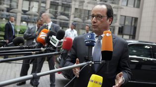 François Hollande à son arrivée au siège de l'Union européenne, à Bruxelles(Belgique),le 7 juillet 2015. (KENZO TRIBOUILLARD / AFP)