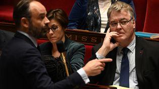 Le Premier ministre Edouard Philippe, le 10 décembre 2019 lors d'une séance à l'Assemblée nationale à Paris, en présence du haut-commissaire aux retraites, Jean-Paul Delevoye. (DOMINIQUE FAGET / AFP)