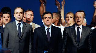 Jean-François Copé, François Fillon et Alain Juppé : trois favoris pour la présidence de l'UMP, ici réunis à Bordeaux (Gironde), le 3 mai 2012. (JEAN-PIERRE MULLER / AFP)