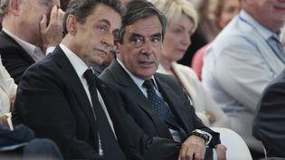 Nicolas Sarkozy et François Fillon, le 30 mai 2015 à Paris. (CHARLY TRIBALLEAU / AFP)