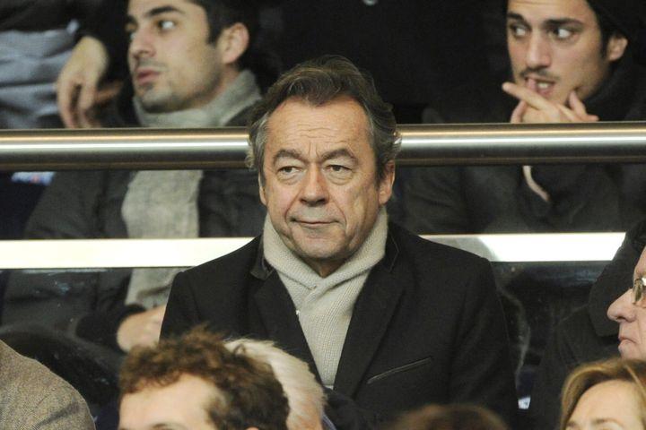 Michel Denisot, dans les tribunes du Parc des Princes le 22 décembre 2013. (JEAN MARIE HERVIO / DPPI MEDIA)