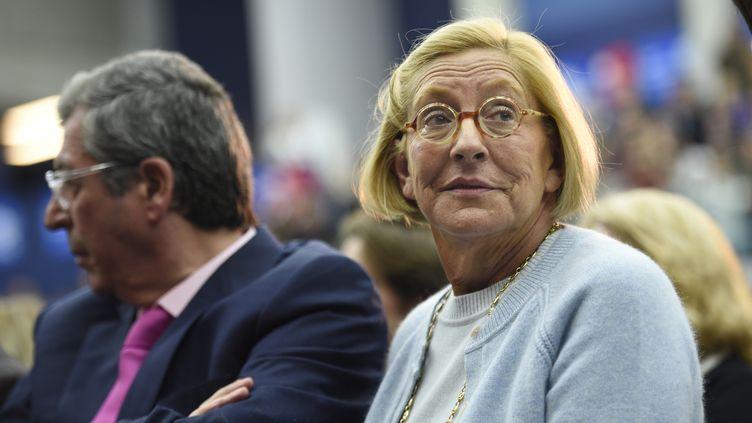 Isabelle Balkany et son mari Patrick, le 25 novembre 2014 lors d'un meeting de l'UMP à Boulogne-Billancourt (Hauts-de-Seine). ( MARTIN BUREAU / AFP )