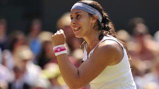 Marion Bartoli après un point marqué contre Sabine Lisicki en finale de Wimbledon, le samedi 6 juillet 2013. (GLYN KIRK / AFP)