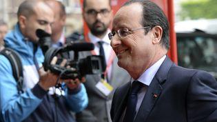 Le président français François Hollande arrive à Bruxelles, le 27 mai 2014, pour une réunion avec le Parti socialiste européen (PSE) suivie d'un dîner informel avec les28 dirigeants de l'Union européenne. (THIERRY CHARLIER / AFP)