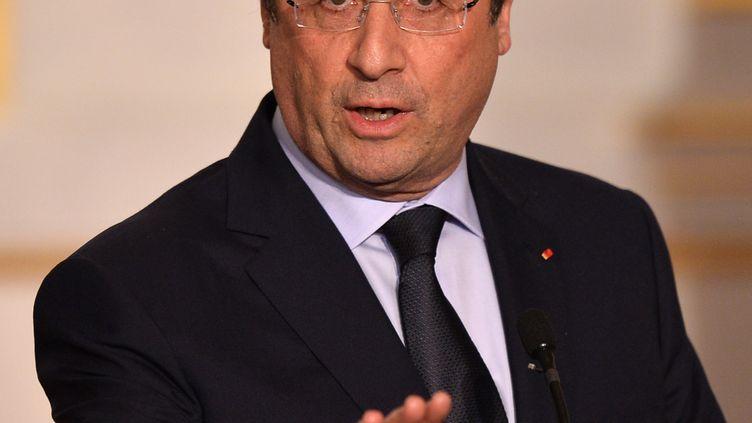 François Hollande à l'Elysée, à Paris, le 26 mars 2014. (MUSTAFA YALCIN / ANADOLU AGENCY / AFP)