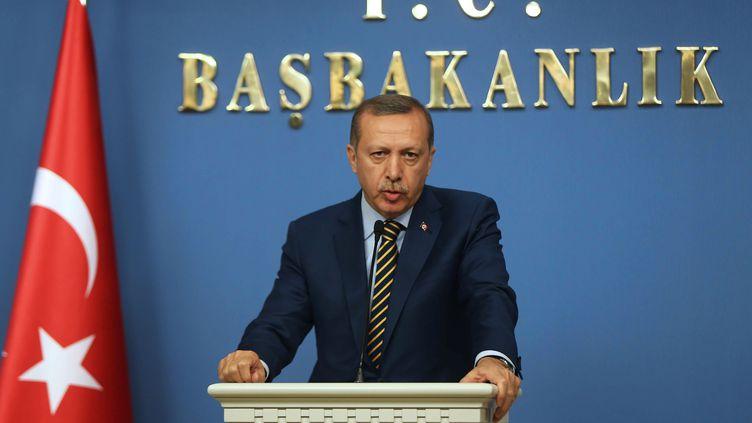 Le Premier ministre turcRecep Tayyip Erdogan annonce un vaste remaniement ministériel, le 25 décembre 2013 à Ankara (Turquie). (ADEM ALTAN / AFP)