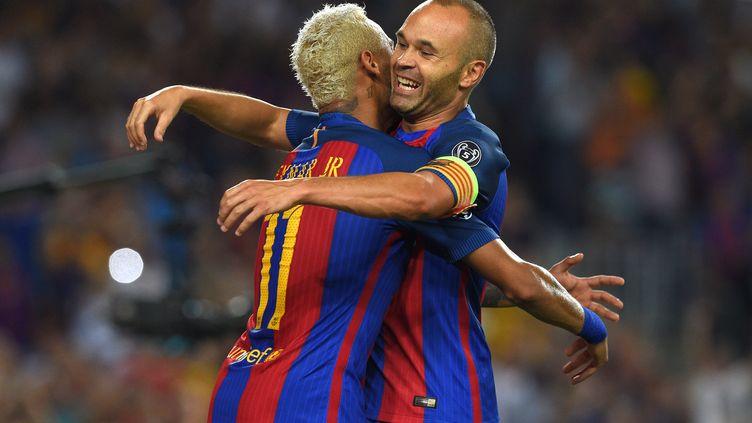 Neymar et Andres Iniesta (LLUIS GENE / AFP)