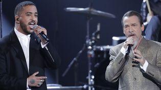 Slimane et Florent Pagny rendent hommage à Johnny Hallyday aux Victoires de la Musique 2018.  (Thomas Samson / AFP)