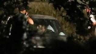 Jacques Rançon (dans la voiture) le 26 juin 2015 lors de la reconstitution du meurtre de Marie-Hélène Gonzalez à Perpignan, en 1998. (AFP)
