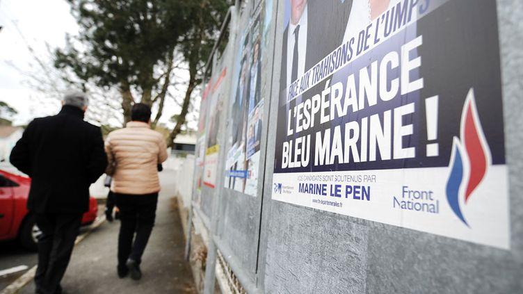 Insultes ou ennuis judiciaires ont entaché la campagne médiatique de certains candidats du Front national aux élections départementales. (JEAN-SEBASTIEN EVRARD / AFP)