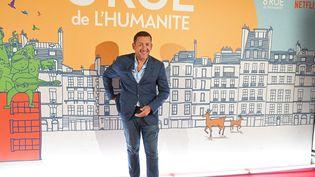 """L'acteur Dany Boon pose durant la promotion deson film """"8 Rue de l'Humanite"""" diffusé à partir de mercredi 22 octobre 2021 sur Netflix (DENIS CHARLET / AFP)"""
