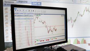 Le taux d'emprunt français à 10 ans est passé, le 5 décembre 2012, sous les 2%, une première historique. (PHILIPPE LISSAC / GODONG / AFP)