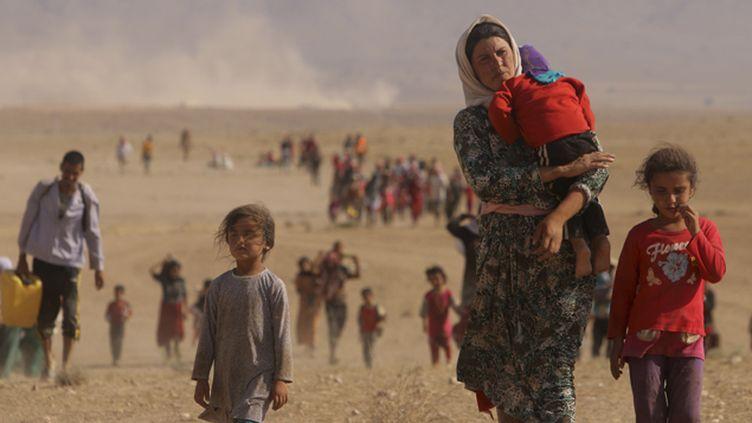 (L'offensive lancée le 9 juin par les djihadistes de l'Etat islamique a forcé des millions de Chrétiens et de Yézidis à fuir © REUTERS/Rodi Said)