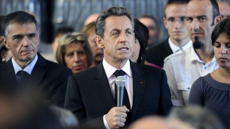 Nicolas Sarkozy s'exprimant devant les salariés d'une entreprise de transport près de Saint-Etienne le 6 septembre 2011 (AFP - PHILIPPE DESMAZES)