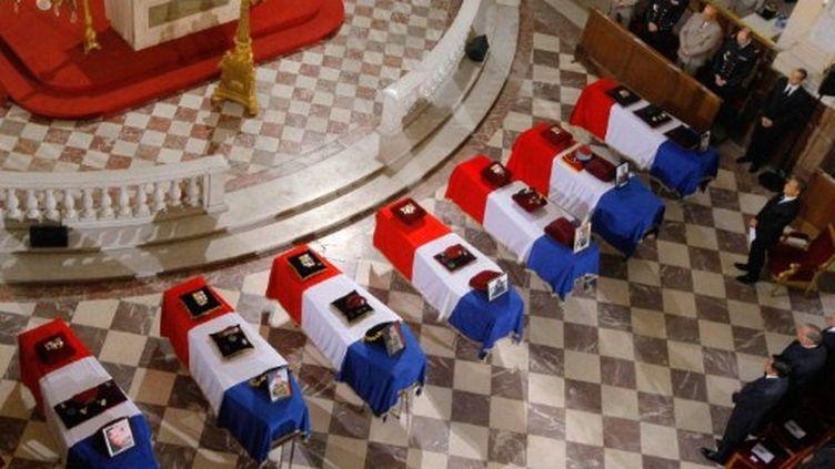 Obèques aux Invalides pour des soldats tués en Afghanistan (19 juillet 2011) (JACQUES BRINON / POOL / AFP)