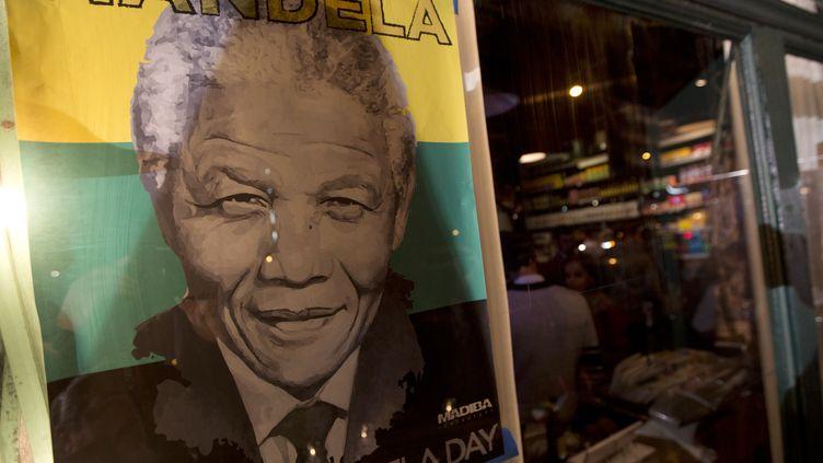 """La façade du restaurant """"Madiba"""", nommé ainsi en l'honneur de Nelson Mandela, à New York (Etats-Unis), le 5 décembre 2013. (CARLO ALLEGRI / REUTERS)"""