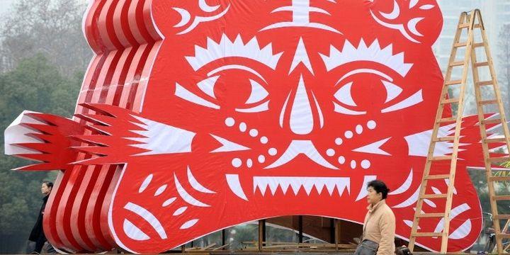 Tigre en papier (chose apparemment puissante, mais en réalité inoffensive) selon une expression de Mao (© AFP/ Miao jian)