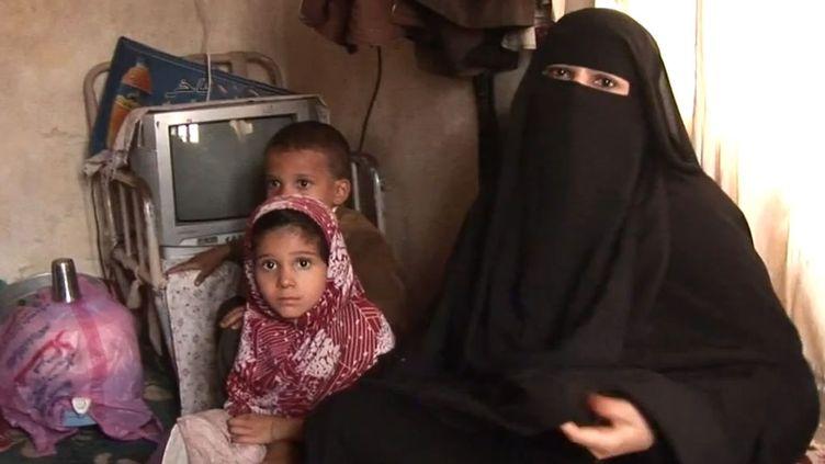 Mère d'une famille de 4 enfants, Oum Hamed ne peut pas les nourrir tous les jours (AFP)
