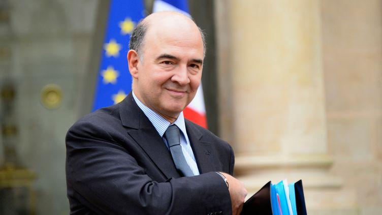 Le ministre de l'Economie, Pierre Moscovici, à l'Elysée, à Paris,le 23 décembre 2013. (BERTRAND GUAY / AFP)
